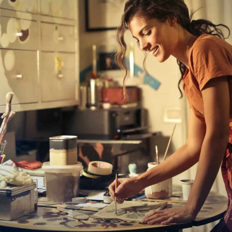 photo of woman painting while smiling and standing by the 3811830 800x800 - Easy Ways For Mom And Dad To Relax